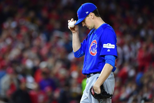 Chicago Cubs starting pitcher Kyle Hendricks stands on the mound during the  2nd inning against the Washington Nationals in Game 5 in the National  League ... c151d2434da
