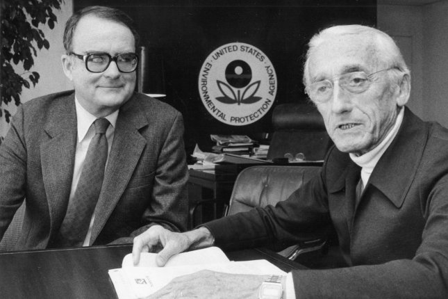 Environmental Protection Agency Administrator William Ruckelshaus (L) meets with underwater explorer Jacques Cousteau on December 7, 1983. Ruckelshausdied Wednesday. File Photo by Don Rypka/UPI