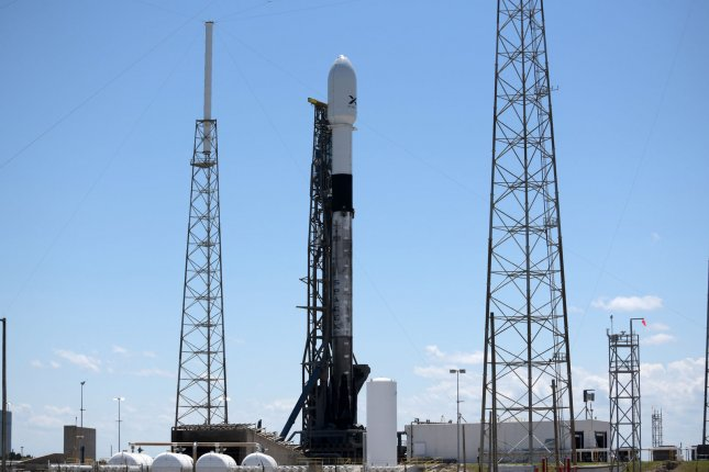 A SpaceX Falcon 9 rocket stands poised to launch the company's Starlink Satellites in May. A similar rocket is scheduled to carry 60 more of the spacecraft into orbit Wednesday. File Photo by Joe Marino-Bill Cantrell/UPI