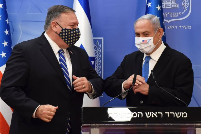 U.S. Secretary of State Mike Pompeo (L) and Israeli Prime Minister Benjamin Netanyahu wear masks as they speak to the press on Monday during a meeting in Jerusalem, Israel. Photo by Debbie Hill/UPI