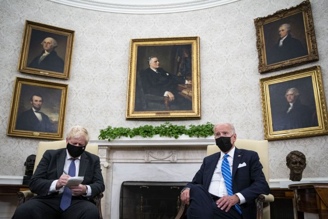 British Prime Minister Boris Johnson praised U.S. President Joe Biden and the United States for doubling their climate finance pledge to help developing countries combat climate change.Pool Photo by Al Drago/UPI