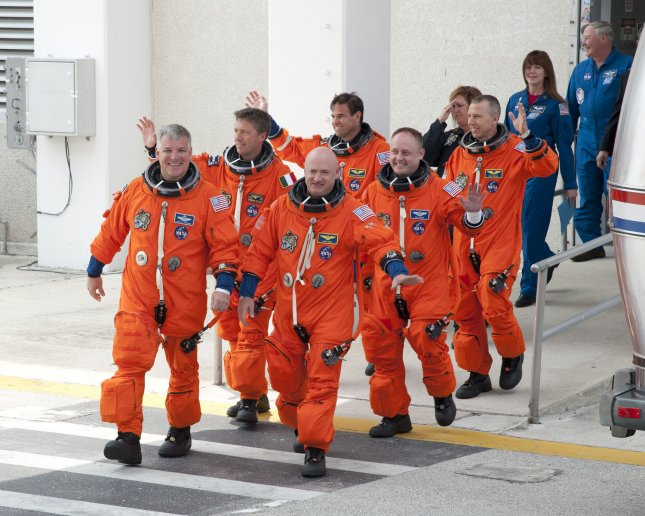 The crew of NASA's space shuttle Endeavour, lead by Commander Mark Kelly (front right), departs from their quarters to Launch Complex 39A at the Kennedy Space Center on April 29, 2011. Endeavour and her crew were to fly on a fourteen day mission, STS 134, to the International Space Station. The launch attempt has been postponed due to a faulty auxiliary power unit heater. NASA has rescheduled the launch to occur in 48 hours. UPI /Joe Marino - Bill Cantrell