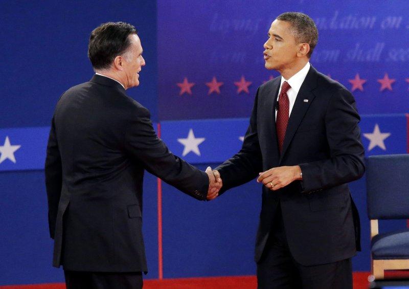 President Barack Obama and Republican nominee Mitt Romney shake hands to finnish the second presidential debate at Hofstra University in Hempstead, New York on October 16, 2012. UPI/John Angelillo