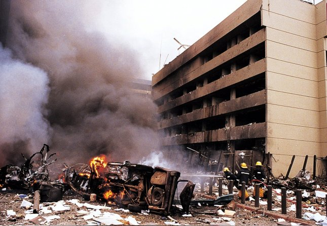 NAI98080702 - 7 AUGUST 1998 - NAIROBI, KENYA: Fire and rescue workers are on the scene moments after a blast at the American Embassy in the Kenyan capital early August 7. Moments later, a seconf bomb exploded outside the U.S. Embassy in Dar Es Salam, Tanzania. cc/Daily Nation- UPI