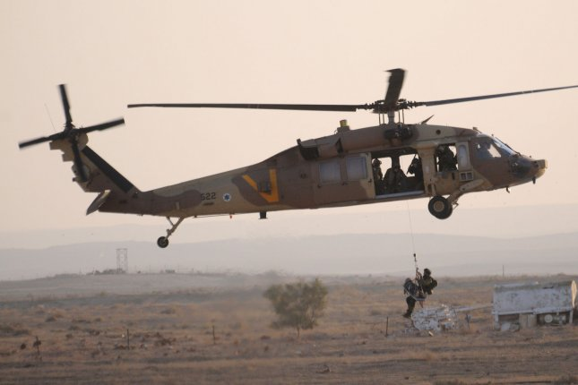 Sikorsky has secured a new deal to build seven UH-60 Black Hawk helicopters for Mexico. Pictured, an Israeli Air Force Black Hawk helicopter crew exhibits their rescue skills during an air show near Beersheva, Israel, December 26, 2013. File photo by Debbie Hill/UPI