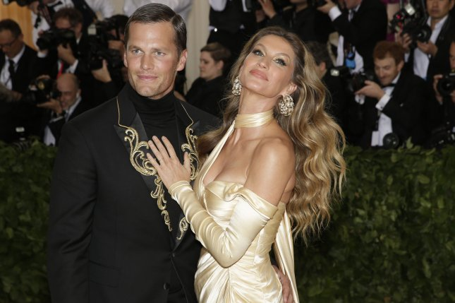 Gisele Bundchen (R), pictured with Tom Brady, said the NFL star filled her apartment with candles and rose petals before popping the question. File Photo by John Angelillo/UPI