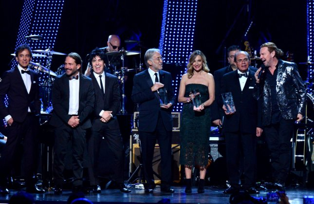 Honorees Mana accept their award onstage from President and CEO of the Latin Recording Academy Gabriel Abaroa, The Recording Academy President Neil Portnow, and Eduardo Hutt at the Latin Grammy Person of the Year gala on Wednesday. Photo by Jim Ruymen/UPI