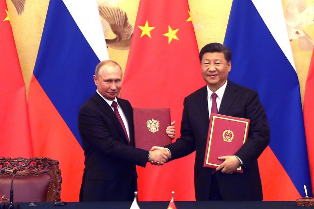Russian President Vladimir Putin (L) and Chinese President Xi Jinping have strengthened military ties as they both stand in opposition to U.S. plans to deploy intermediate-range missiles in the Asia Pacific. File Photo by Stephen Shaver/UPI