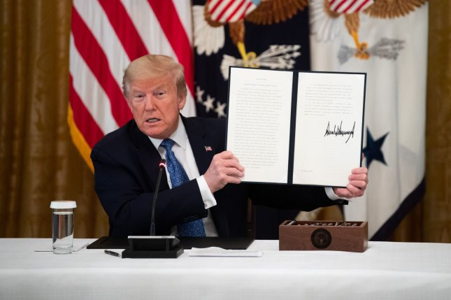 President Donald Trump signed an executive order on Tuesday directing federal agencies to review regulations that have been suspended in response to the coronavirus pandemic and cut any that would hinder economic recovery. Photo by Kevin Dietsch/UPI