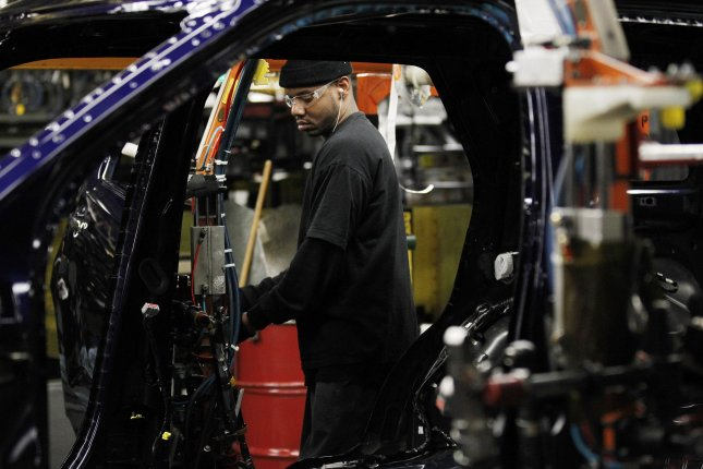 A worker assembles Ford sport-utility vehicles at the automaker's plant in Chicago, Ill. File Photo by Brian Kersey/UPI