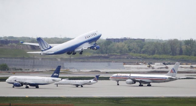 A United Airlines Boeing 747 takes off as planes from JetBlue, Continental Airlines and American Airlines park at O'Hare International Airport in Chicago on May 3, 2010. UPI/Brian Kersey