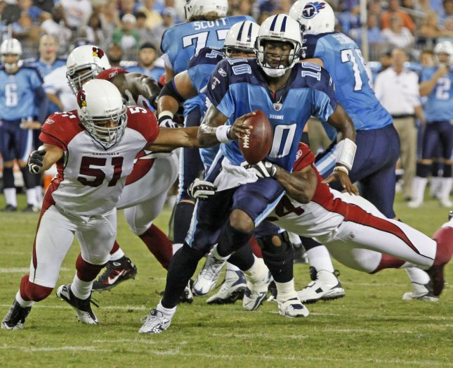 Tennessee Titans quarterback Vince Young (10) scrambles for a 3 yard gain on 1st and 10 before being tackled by Arizona Cardinals linebacker Paris Lenon (51) and safety Adrian Wilson (24) in the first period of an NFL game at LP Field in Nashville, Tennessee on August 23, 2010. (UPI Photo/Fred erick Breedon IV)