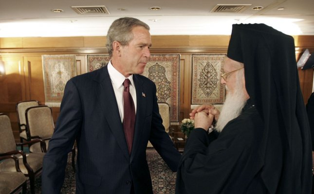 President George W. Bush talks with Ecumenical Patriarch Bartholomew I after a meeting with religious leaders in Istanbul, Turkey on June 27, 2004. ..(UPI Photo)