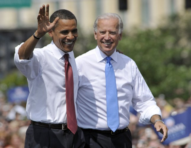 Presidential candidate Barack Obama and Joe Biden greet the crowd at an Aug. 23, 2008, Springfield, Ill., rally during which Obama confirmed Biden would be his running mate. (UPI Photo/Darrell Hoemann)