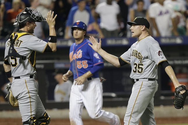Pittsburgh Pirates Chris Stewart and relief pitcher Mark Melancon celebrate after the game ends in the 14th inning against the New York Mets at Citi Field in New York City on August 15, 2015. The Pirates defeated the Mets 5-3 in extra innings. Photo by John Angelillo/UPI