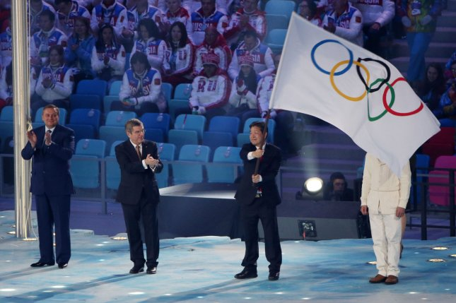 Lee Seok-rae (R), mayor of Pyeongchang, South Korea receiving the Olympic flag from International Olympic Committee President Thomas Bach (C) after it was passed from Sochi Mayor Anatoly Pakhomov during the Closing Ceremony at the Sochi 2014 Winter Olympics on February 23, 2014. The 2018 Winter Olympics could bring North and South Korea together. UPI/Kevin Dietsch