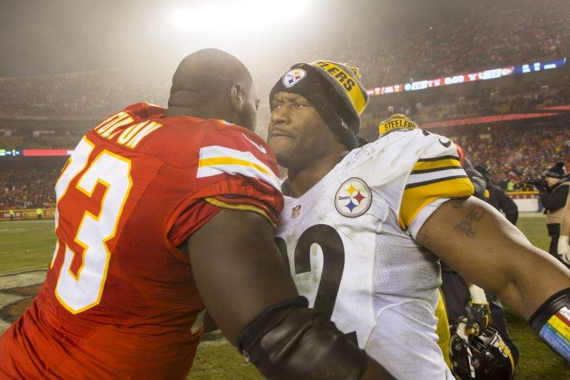69e756978b7 Kansas City Chiefs guard Zach Fulton and Pittsburgh Steelers outside  linebacker James Harrison hug after an NFL Playoff game on January 15 at  Arrowhead ...