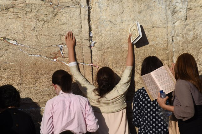Jewish women pray at the Western Wall, Judaism's holiest site, in the Old City of Jerusalem in June. The role of women at the site has been a point of contention between liberal and orthodox Jews. Photo by Debbie Hill/UPI