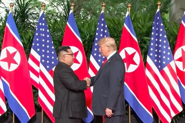 U.S. President Donald Trump shakes hands with North Korean leader Kim Jong Un on Tuesday morning local time at Singapore's Capella Hotel in what is the first meeting between a sitting U.S. president and a North Korean leader. Photo from Pool TV/UPI