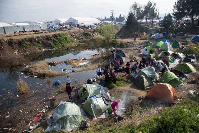 Mothers, their children and other family members are seen in a makeshift refugee camp in Idomeni, Greece in April 2016. The EU Court of Justice ruled Thursday three nations violated rules that required them to take in some of the migrants. File Photo by David Caprara/UPI
