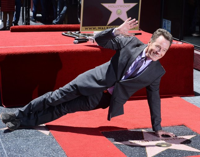 Bryan Cranston strikes a pose during an unveiling ceremony honoring him with the 2,502nd star on the Hollywood Walk of Fame in Los Angeles on July 16, 2013. UPI/Jim Ruymen