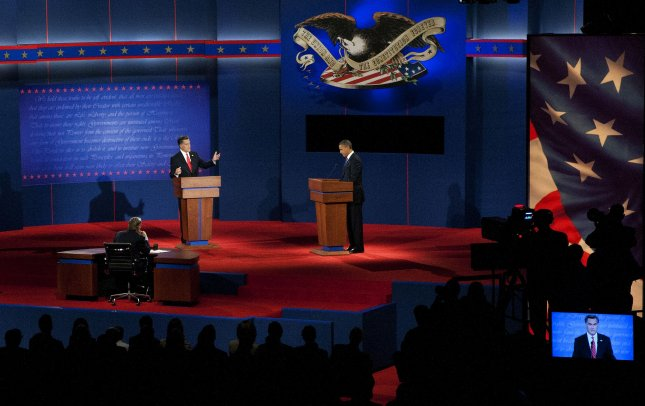 Republican Presidential nominee Mitt Romney speaks while President Barack Obama makes notes at the first Presidential debate at the University of Denver's Ritchie Center last Wednesday in Denver. UPI/Gary C. Caskey