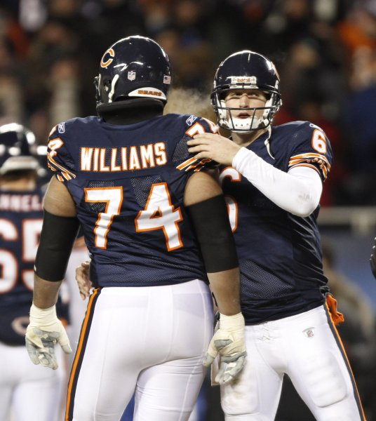 Chicago Bears quarterback Jay Cutler (R) hugs Chicago Bears offensive tackle Chris Williams after the Bears kicked an extra point during the fourth quarter against the Minnesota Vikings at Soldier Field in Chicago on December 28, 2009. The Bears won 36-30 in overtime. UPI/Brian Kersey