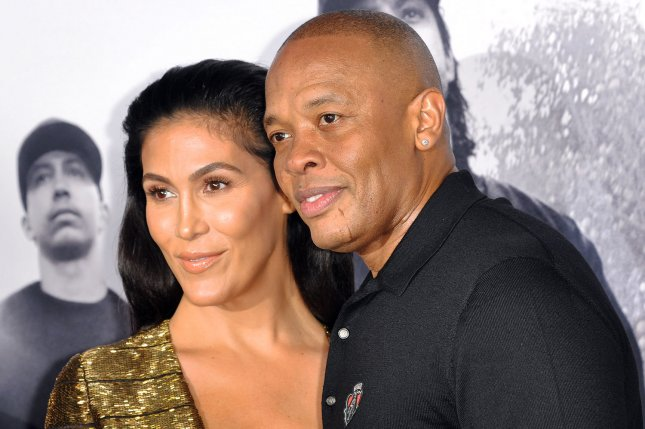 Producer Dr. Dre and his wife Nicole Threatt Young attend the premiere of the N.W.A. motion picture biopic Straight Outta Compton at Microsoft Theater in Los Angeles on Aug. 10, 2015. The sequel will not involve the real Dr. Dre and is rumored to follow a book following the history of Death Row Records. Photo by Christine Chew/UPI