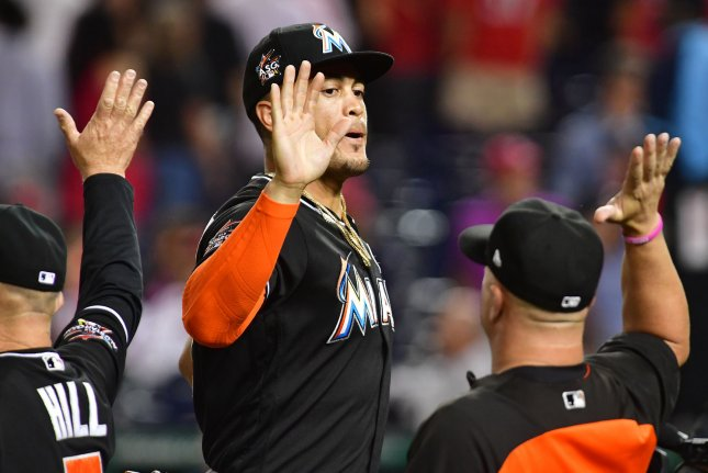 Miami Marlins Giancarlo Stanton celebrates with teammates after the Marlins defeated the Nationals 7-3 at Nationals Park in Washington, D.C. on August 8, 2017. File photo by Kevin Dietsch/UPI