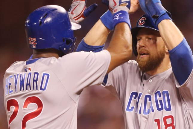 Chicago Cubs' Ben Zobrist (18) greets Jason Hayward at home plate after Heyward hit a two run home run in the eighth inning against the St. Louis Cardinals on June 16 at Busch Stadium in St. Louis. Photo by Bill Greenblatt/UPI