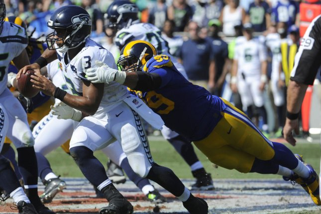 Los Angeles Rams defensive tackle Aaron Donald tackles Seattle Seahawks quarterback Russell Wilson in the first half on October 8, 2017 at the Memorial Coliseum in Los Angeles. Photo by Lori Shepler/UPI