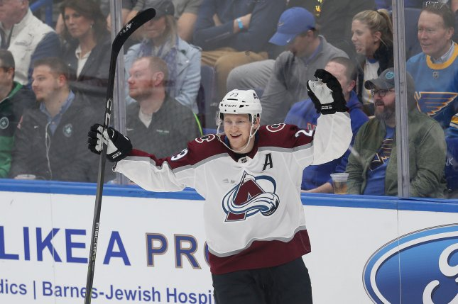 Colorado Avalanche forward Nathan MacKinnon raises his arms after scoring his second goal of the first period against the St. Louis Blues on March 15, 2018 at the Scottrade Center in St. Louis. Photo by Bill Greenblatt/UPI
