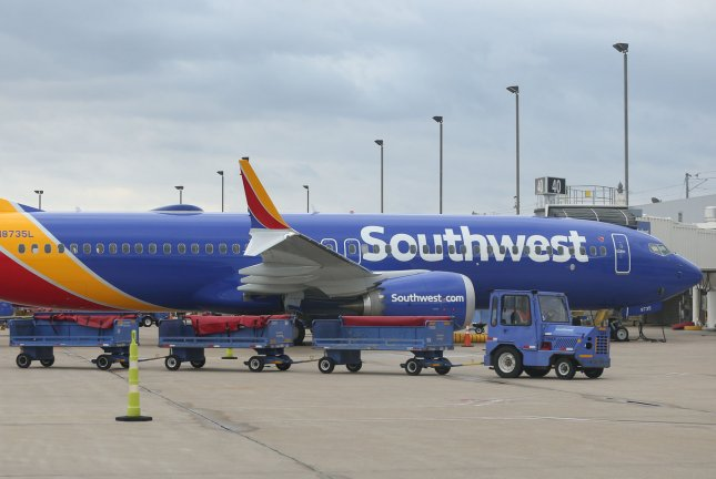 A baggage cart passes a Southwest 737 Max 8 airliner as it sits at Gate 40 at St. Louis-Lambert International Airport in St. Louis. Mo., on March 13. File Photo by Bill Greenblatt/UPI