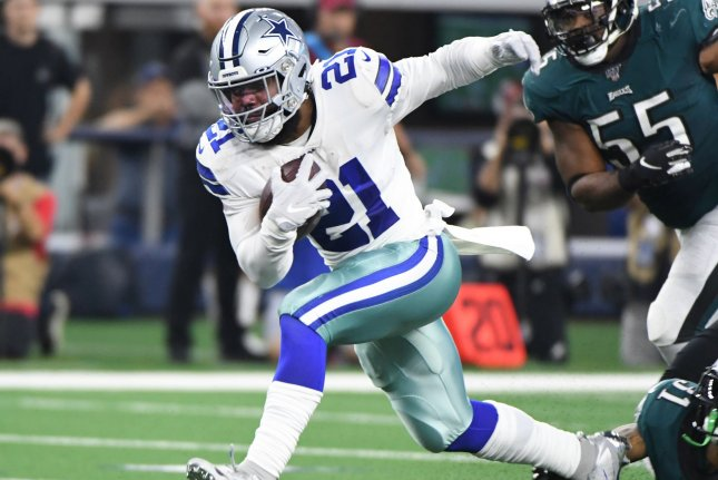Dallas Cowboys running back Ezekiel Elliott (21), who has been diagnosed with COVID-19, said he doesn't know how the NFL can keep players healthy this season. File Photo by Ian Halperin/UPI