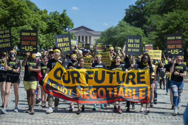Members of the Sunrise Movement called on President Joe Biden Monday to push for an infrastructure bill including key climate change provisions. Photo by Bonnie Cash/UPI