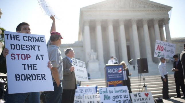 Supporters of Arizona's immigration bill, SB 1070, rally in front of the U.S. Supreme Court as the court hears oral arguments on the constitutionality of the law, in Washington, D.C. on April 25, 2012. UPI/Kevin Dietsch