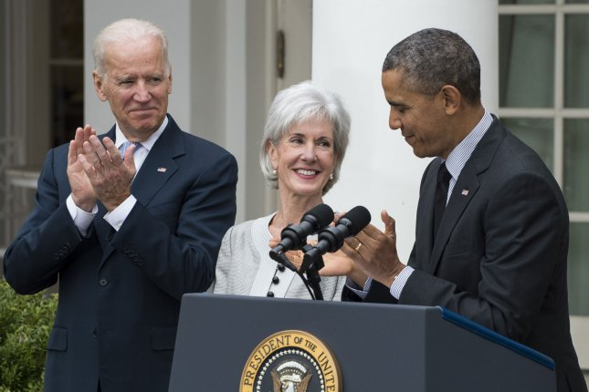 President Barack Obama praises outgoing Health and Human Services Secretary Kathleen Sebelius as Vice President Joe Biden applauds during event in the Rose Garden at the White House in Washington, DC on April 11, 2014. Obama accepted Sebelius resignation and nominated Burwell for HHS Secretary. UPI/Pat Benic