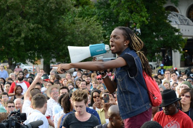 Jay D. Mitchell, of Pagedale, Missouri leads a chant Hands up, don't shoot after protesters held a moment of silence for Michael Brown under the Gateway Arch on August 14, 2014. Brown was shot and killed by a Ferguson police officer on August 9, 2014 sparking riots in the St. Louis suburb of Ferguson, Missouri. UPI/David Broome