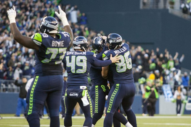 Former Seattle Seahawks offensive tackle Michael Bowie signals the winning field goal as long snapper Clint Gresham (49) and tight end Zach Miller (86) celebrates with kicker Steven Hauschka (4) after he kicked a 27-yard field goal against the Tampa Bay Buccaneers in overtime at CenturyLink Field in Seattle, Washington. File photo by Jim Bryant/UPI