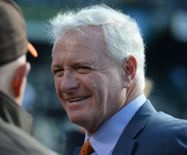 Cleveland Browns owner Jimmy Haslam talks with Browns personnel on the sidelines before a game in 2012. File photo by Terry Schmitt/UPI