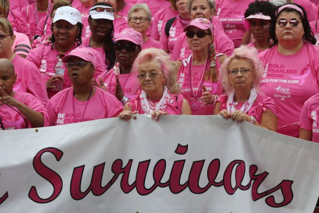 Breast cancer survivors march to the stage before the start of the Koman Race for the Cure in St. Louis on June 9, 2018. A study found pPostmenopausal women who survive breast cancer may have a higher risk for developing heart disease. File Photo by Bill Greenblatt/UPI