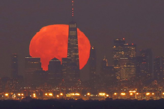 A Blue Moon rises behind One World Trade Center and the Manhattan skyline shorty after sunset on Halloween Night on Saturday, in Green Brook Township, N.J. A blue moon only happens on Halloween approximately every 19 years. Photo by John Angelillo/UPI