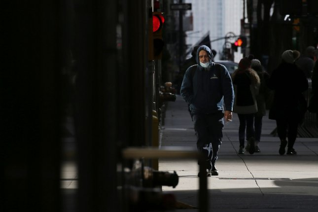 Researchers say that while some smokers quit early in the COVID-19 pandemic, many, like the pedestrian pictured in New York City in November, either didn't quit or smoked more to help cope with stress. File Photo by John Angelillo/UPI