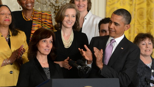 Carol Metcalf is applauded by President Barack Obama prior to his comments on his signature healthcare program. Officials announced today a year-long delay of the employer mandate. UPI/Pat Benic