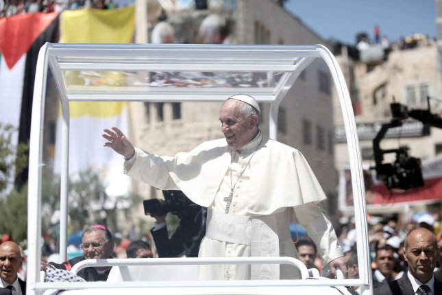 Pope Francis arrives to lead an open-air mass in the Manger Square next the Nativity Church in the West Bank city of Bethlehem on May 25. 2014. The pope has invited Israel and Palestinian officials to the Vatican to pray for peace. (UPI/Fadi Arouri/Pool)