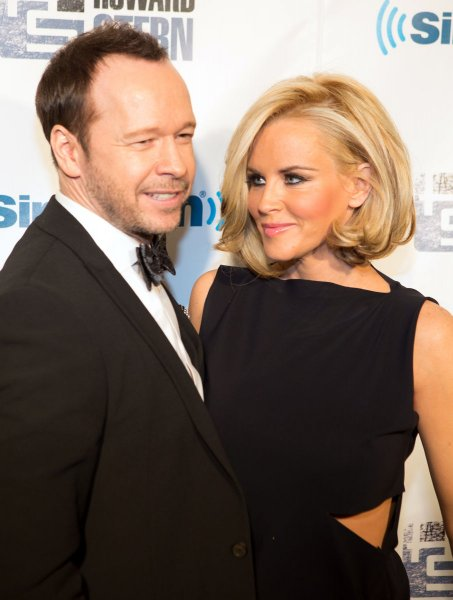 Jenny McCarthy (R) says husband Donnie Wahlberg is 'wonderful' in bed. (UPI/Justin Alt)