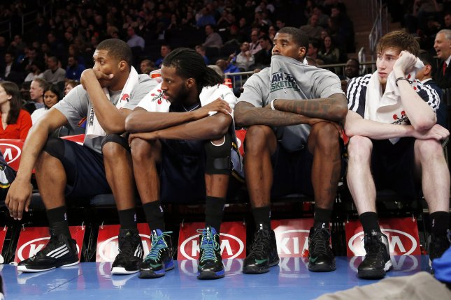 Utah Jazz Derrick Favors, DeMarre Carroll, Marvin Williams and Gordon Hayward (R) react on the bench in the final minutes of the game against the New York Knicks at Madison Square Garden in New York City on March 9, 2013.The Knicks defeated the Jazz 113-84. UPI/John Angelillo