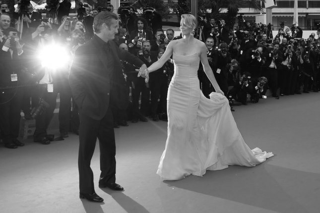 Sean Penn and Charlize Theron arrive at the screening for Mad Max: Fury Road during the 68th annual Cannes International Film Festival in France on May 14, 2015. Penn and Theron have reportedly ended their romance after about 18 months. Photo by David Silpa/UPI