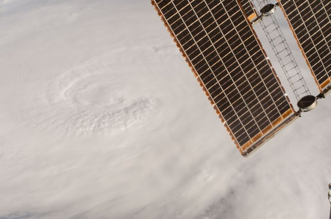 A view of Hurricane Matthew from the International Space Station. The Category 3 storm left far fewer power outages in its wake than Hurricane Sandy, a Category 1 storm. NASA/UPI