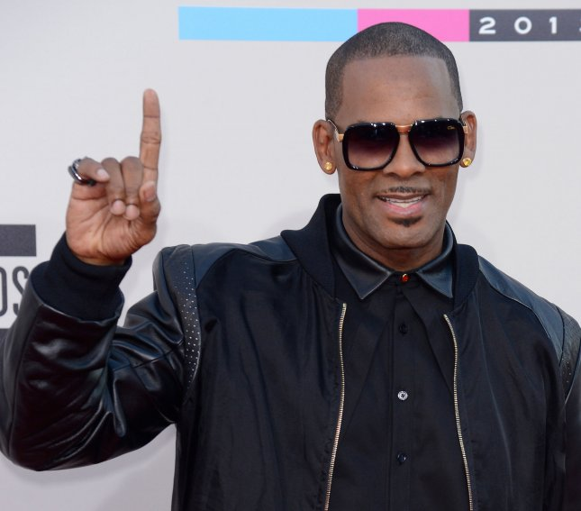 R. Kelly arrives for the 41st annual American Music Awards on November 24, 2013. Kelly has said that he is alarmed and disturbed regarding allegations that he keeping women in an abusive cult. File Photo by Phil McCarten/UPI
